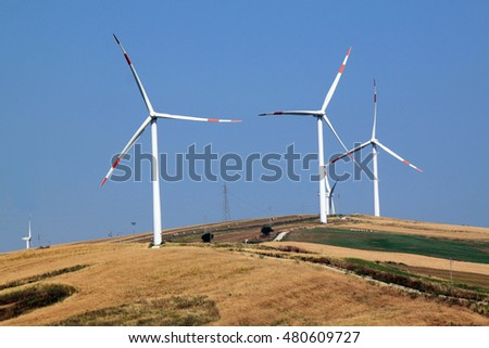 windmills on the field for electric power production