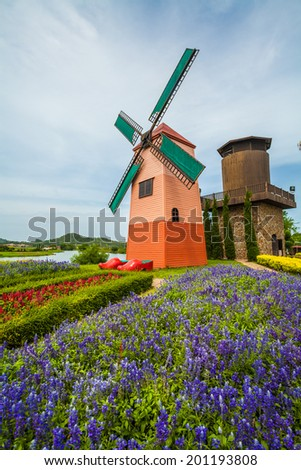 windmills over rows of lavender field - stock photo
