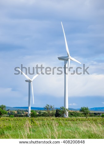 Windmills standing in fiels during summer - stock photo