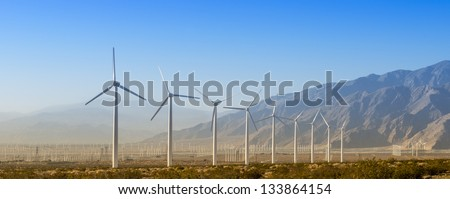 Windmills with Mountains - stock photo
