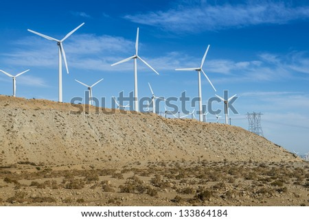 Windmills With Transmission towers - stock photo
