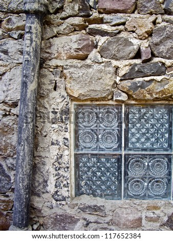 Window and drainpipe on old Mexican building - stock photo
