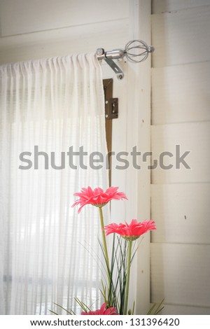 window and pink flowers - stock photo