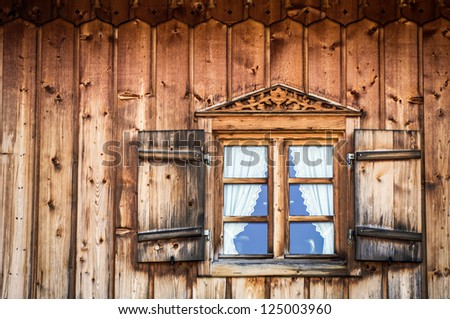 window at a typical old bavarian farmhouse - stock photo