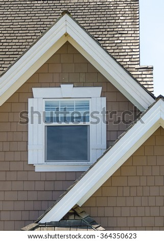 Window at the roof of the house.