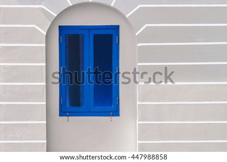 Window blue pastel frame on old building stucco wall, background, texture, vintage, pattern