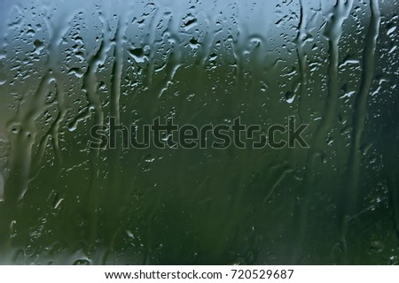 Window by rain in Waterfront Lodge in Knysna town, South Africa.