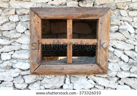Window cut into the stone  without glass - stock photo