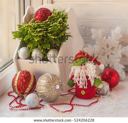 "Window decor for the holiday of St. Nicholas with toys and Selaginella martensii ""Watsoniana"" (mass-produced)"
