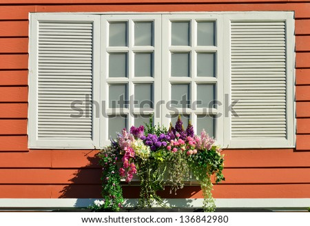 Window decorated with fresh flowers - stock photo