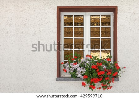 Window decorated with red flowers with copy space