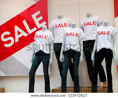 window display with text SALE in a shop