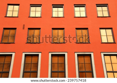 window frame exterior in red wall - stock photo