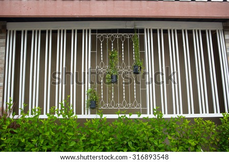 Window grill stock images royalty free images vectors for Window design bangladesh