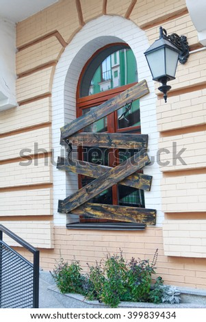 Window in a classic style and decoration of wooden planks. Architecture - stock photo