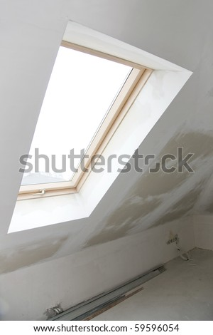 window in a house under construction - stock photo
