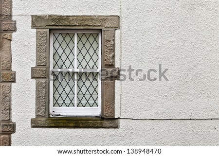 Window in a stone cottage in Scotland - stock photo