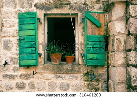 Window in an old stone house, Window on the Facade of French Stone House - stock photo
