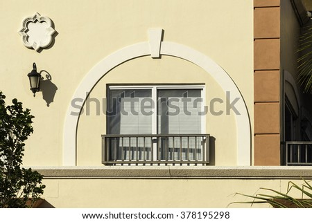 Window in arch - stock photo