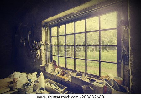 Window in carpenter's workshop, vintage style. - stock photo