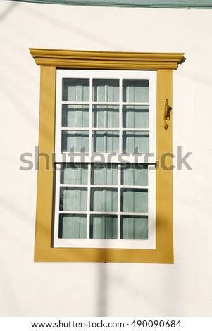 window in colonial house in paracatu, colonial town in brazil
