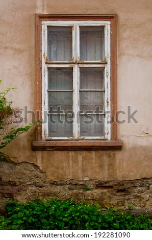Window in old style on green wall - stock photo