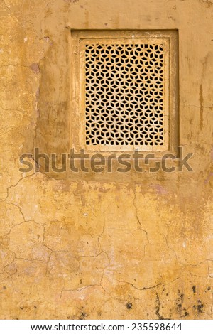 Window in the wall. Hawa Mahal, the Palace of Winds, Jaipur, Rajasthan, India. - stock photo