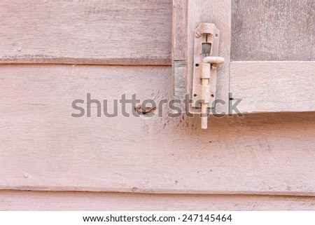 window latch on a old grungy timber