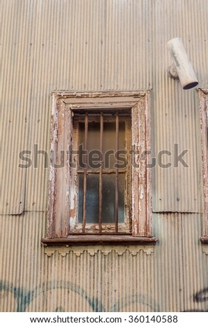 Window of a colorful house in the center of Valparaiso, Chile - stock photo