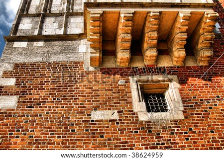 Window of a medieval building, very old brick wall - stock photo