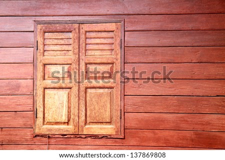 Window of a old wooden cottage - stock photo