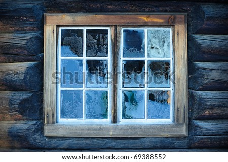Window of a traditional Norwegian hut with frost patterns - stock photo