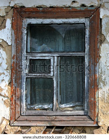 Window of an old abandoned farmhouse - stock photo