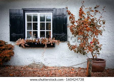 window of english house in autumn - stock photo