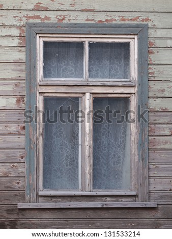 window of old wooden house - stock photo