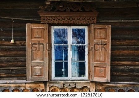 Window Of The Old House With Opened Shutters - stock photo