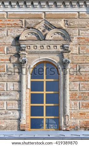 Window of the old synagogue with decorative elements. Grodno, Belarus. - stock photo