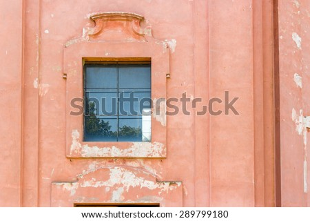Window of the rigid and severe architecture of the Shrine of Our Lady of Health of Solarolo in Italy, church from the 18th century devoted to the Blessed Virgin Mary - stock photo