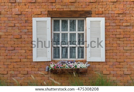 Window on a red brick wall