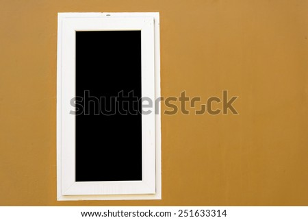 Window on beige colour wall - stock photo