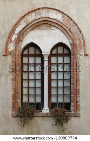 Window on historical Italian wall - stock photo