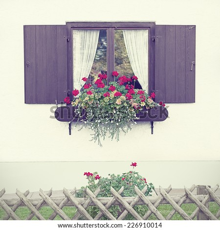 Window on the facade of vintage German house. Toned filtered image in a nostalgic retro style.  - stock photo