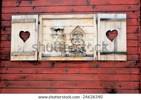 Window on the wooden house - stock photo