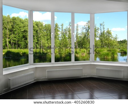 window overlooking the landscape with summer forest lake