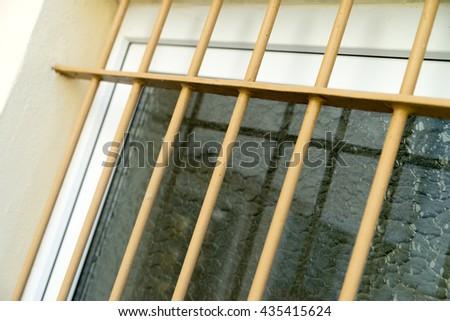 Window protected by iron bars / Iron bars - stock photo