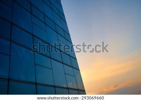 Window reflection and sunset sky - stock photo