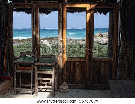 Window seascape view from old wooden frame room - stock photo