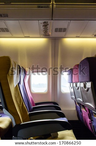 Window seats on airplanes - stock photo