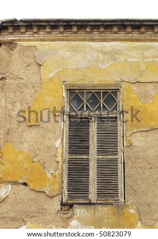 Window shutter of an old abandoned house - stock photo