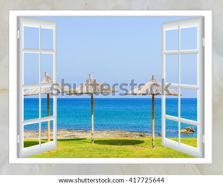 window the door with the key views of the sea beach with an umbrella and a lawn green - stock photo